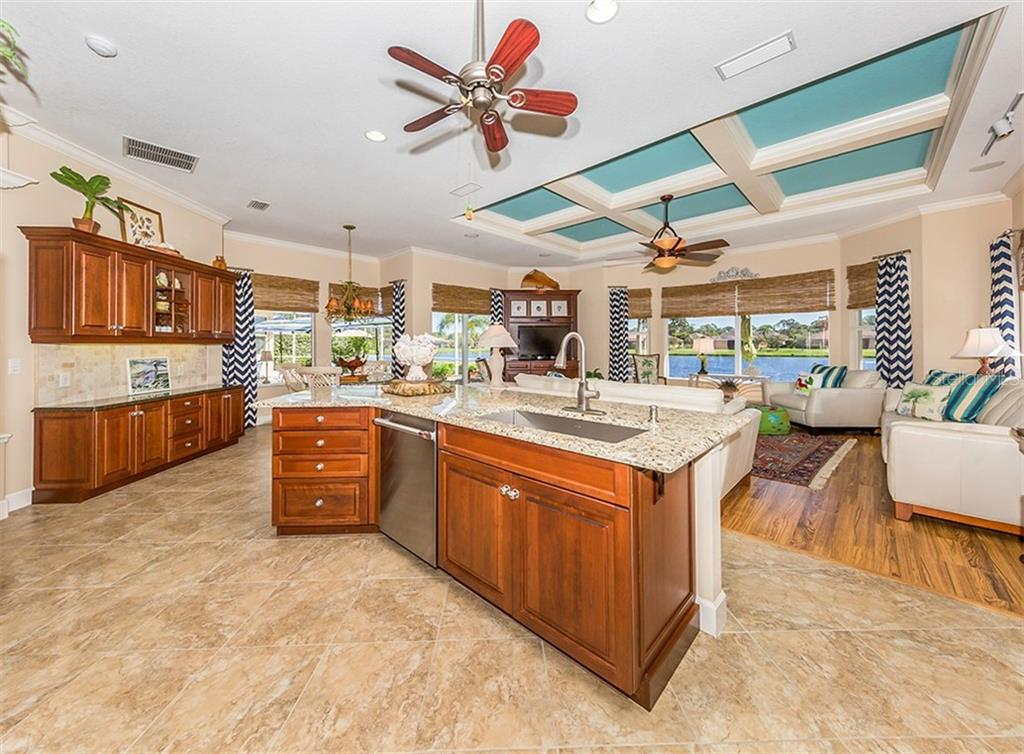 Kitchen, family room with view - Single Family Home for sale at 19799 Cobblestone Cir, Venice, FL 34292 - MLS Number is N6104694