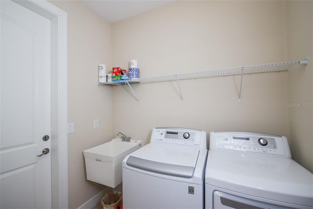 Utility Room with access to garage.  These are top of the line washer & dryer units. - Single Family Home for sale at 111 Nolen Dr, Venice, FL 34292 - MLS Number is N6105084