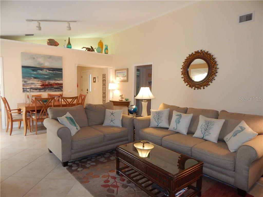 COZY LIVING ROOM - Villa for sale at 572 Clubside Cir #34, Venice, FL 34293 - MLS Number is N6105221