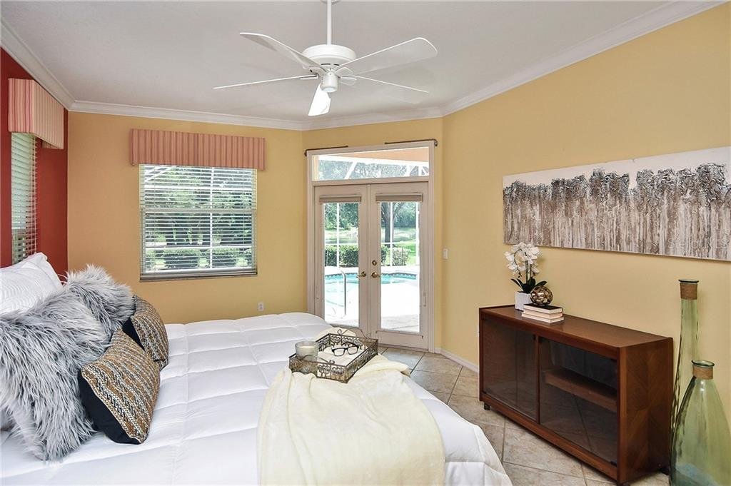 Master Bedroom with french doors leading out to pool area - Single Family Home for sale at 322 Dulmer Dr, Nokomis, FL 34275 - MLS Number is N6105498