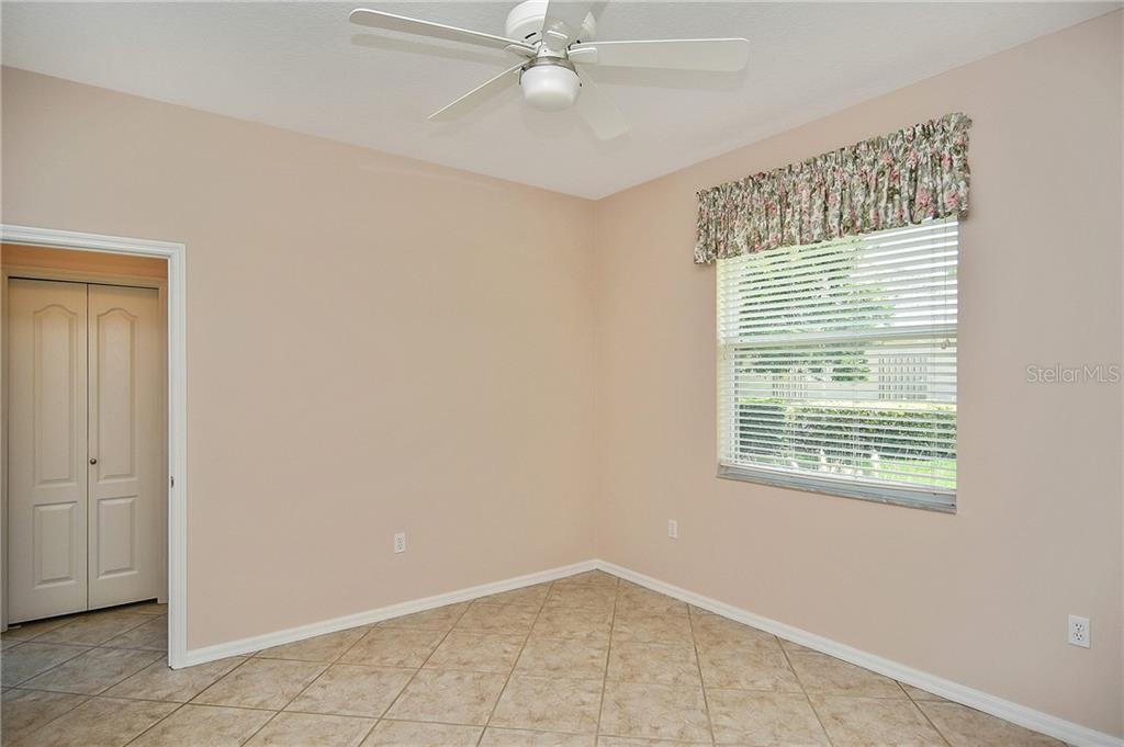 Bedroom 3 with tile floors - Single Family Home for sale at 322 Dulmer Dr, Nokomis, FL 34275 - MLS Number is N6105498