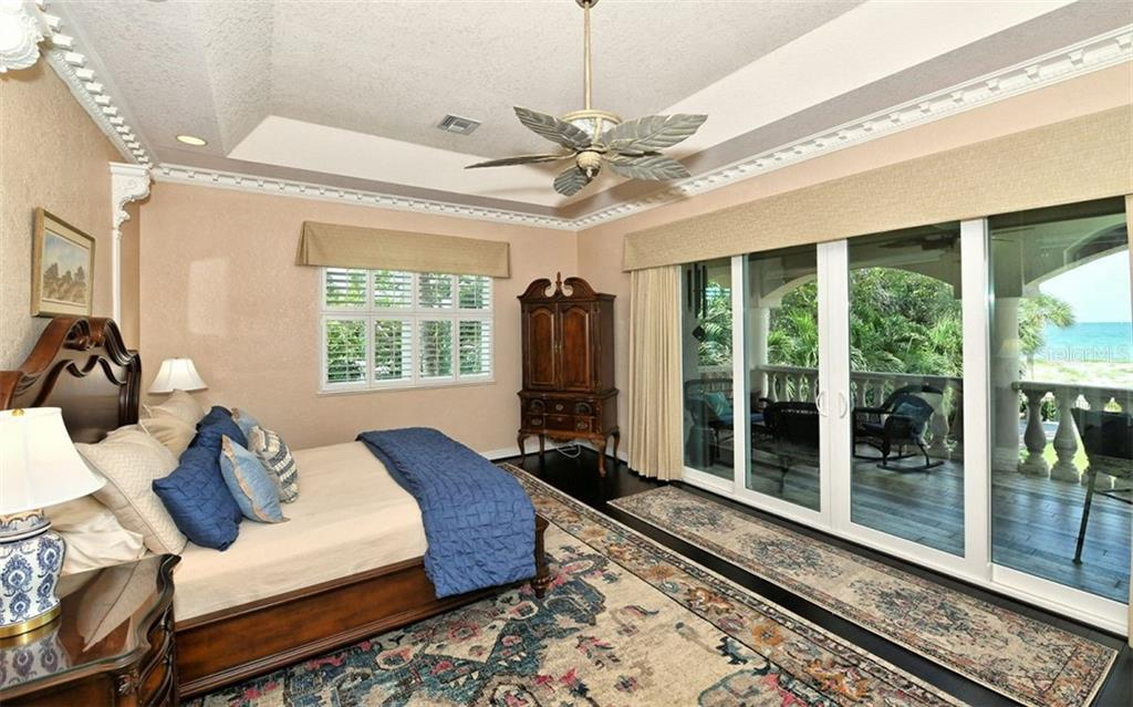 2nd floor master bedroom with sliders to balcony/terrace - Single Family Home for sale at 412 Hunter Dr, Venice, FL 34285 - MLS Number is N6105563