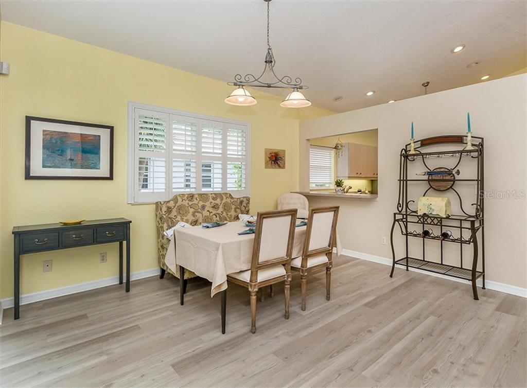 Dining room with pass through to kitchen - Single Family Home for sale at 836 Connemara Cir, Venice, FL 34292 - MLS Number is N6105684