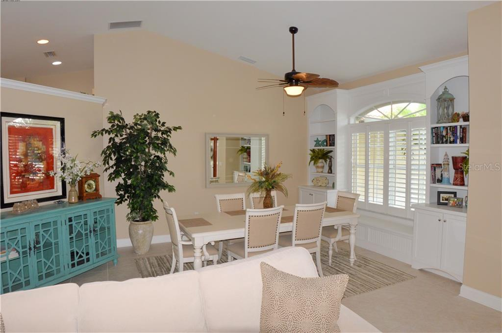 Dining room from living room - Single Family Home for sale at 537 Lake Of The Woods Dr, Venice, FL 34293 - MLS Number is N6106043