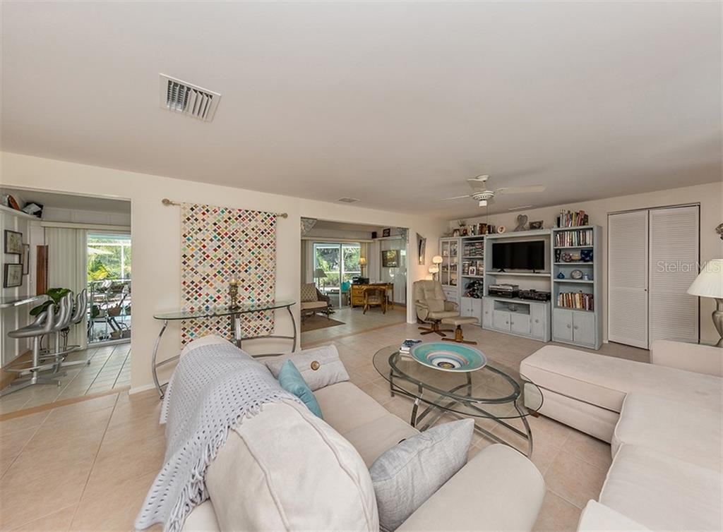 Great room to Florida room - Single Family Home for sale at 429 Beach Park Blvd, Venice, FL 34285 - MLS Number is N6106119