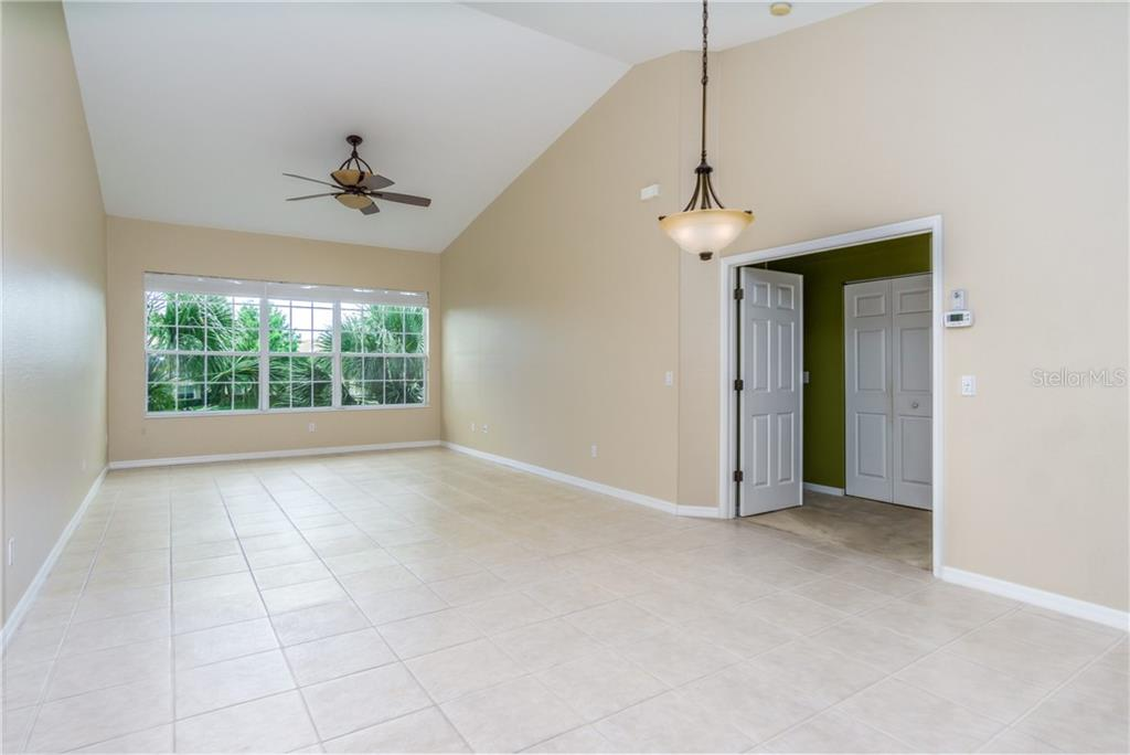 Large Windows with Tree Top View - Condo for sale at 1910 Triano Cir #1910, Venice, FL 34292 - MLS Number is N6106332