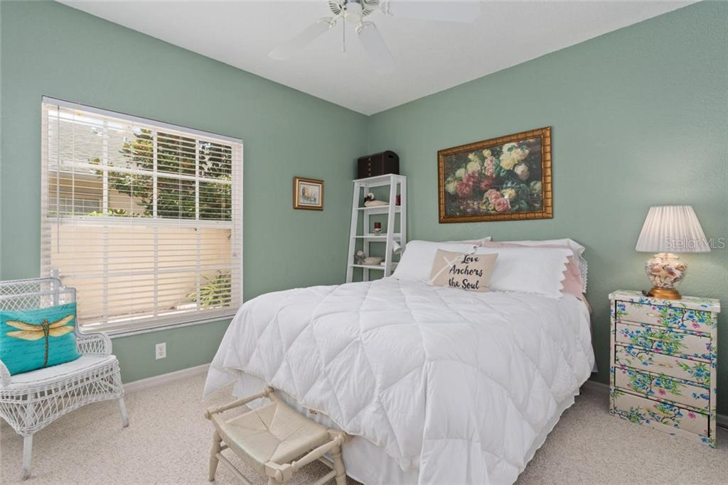 Guest bedroom - Villa for sale at 1708 Fountain View Cir, Venice, FL 34292 - MLS Number is N6106422