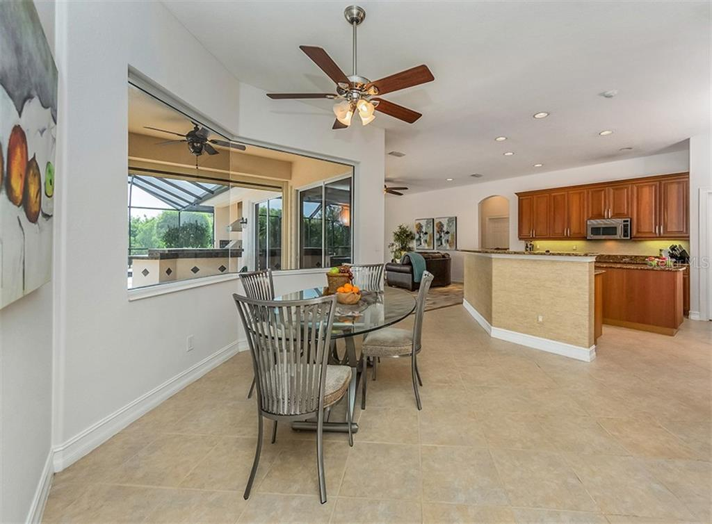 Dinette to kitchen. - Single Family Home for sale at 262 Pesaro Dr, North Venice, FL 34275 - MLS Number is N6107589