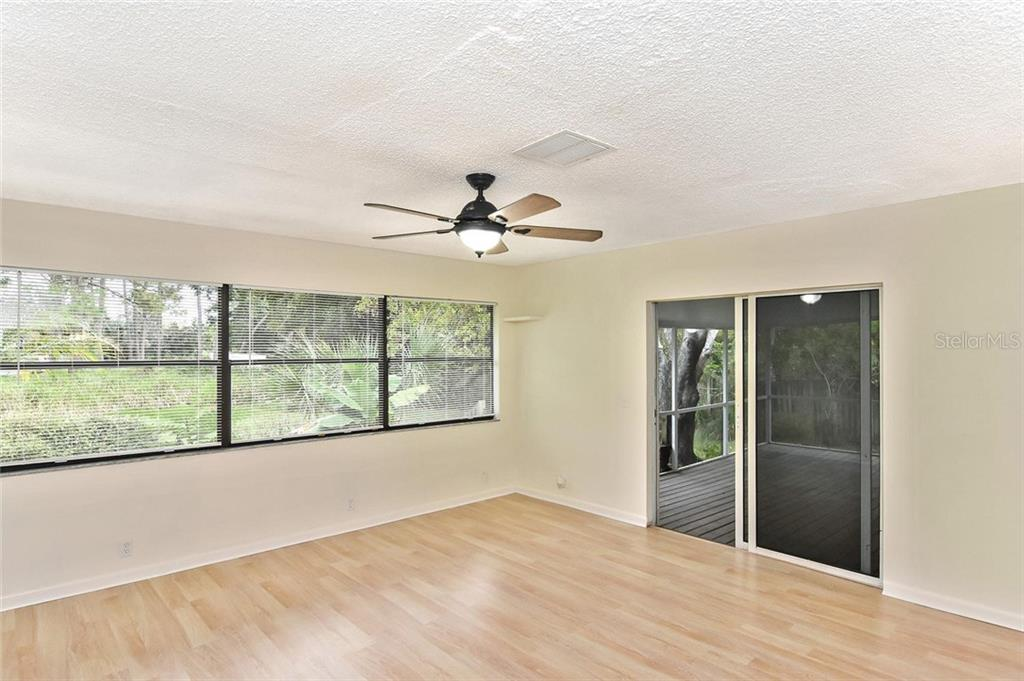Family room overlooking backyard - Single Family Home for sale at 5681 Hale Rd, Venice, FL 34293 - MLS Number is N6107822