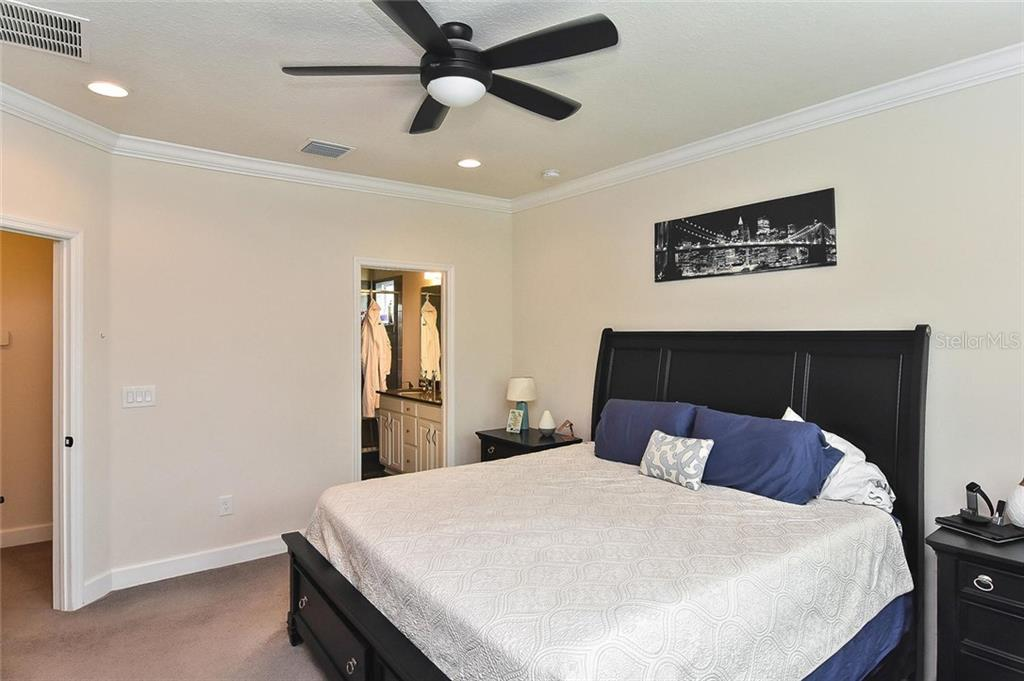Master bedroom to master bath - Townhouse for sale at 10713 Avery Park Dr, Riverview, FL 33578 - MLS Number is N6107928