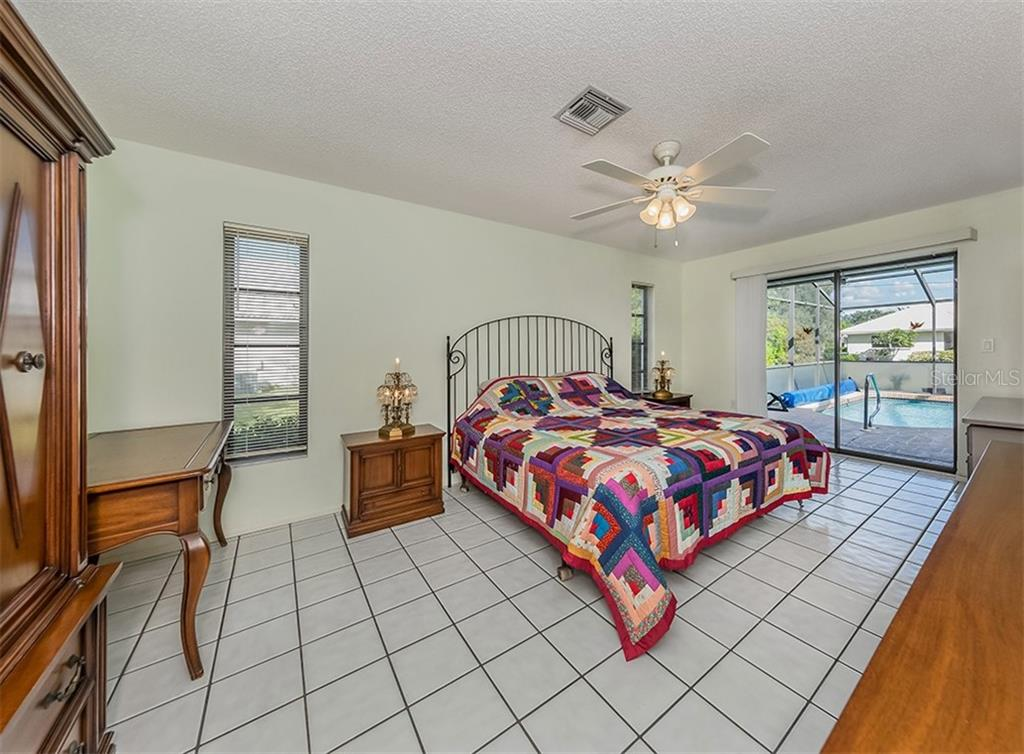 Master bedroom with sliders to the pool - Single Family Home for sale at 1569 Vermeer Dr, Nokomis, FL 34275 - MLS Number is N6108096