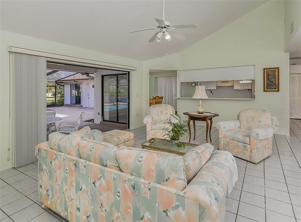 Living room, lanai, dinette, kitchen - Single Family Home for sale at 1569 Vermeer Dr, Nokomis, FL 34275 - MLS Number is N6108096