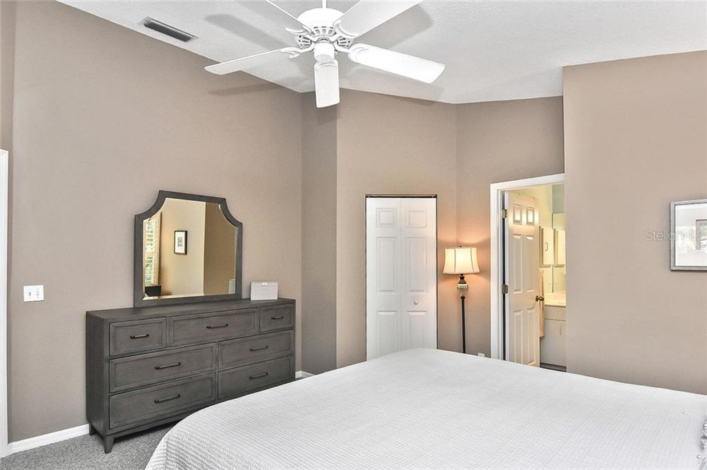 Owner's Suite with doors to walk-in closet and bathroom - Condo for sale at 817 Montrose Dr #204, Venice, FL 34293 - MLS Number is N6108125
