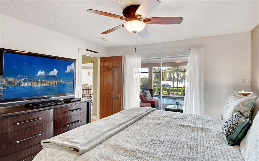 Master suite w/ sliders to lanai and view of the ICW - Single Family Home for sale at 925 Bayshore Rd, Nokomis, FL 34275 - MLS Number is N6108586