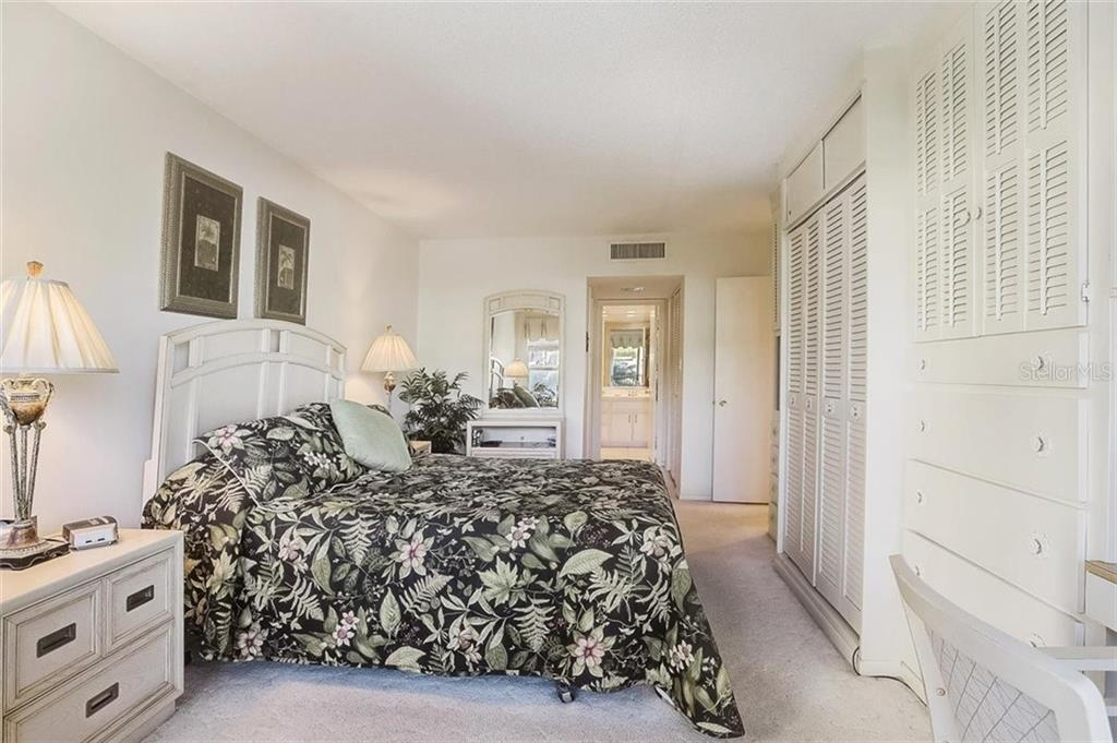 Master bedroom with slider to lanai - Condo for sale at 1150 Tarpon Center Dr #203, Venice, FL 34285 - MLS Number is N6108842