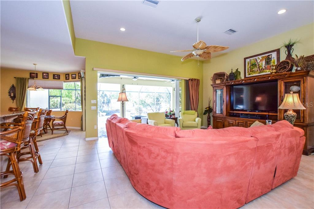 Great room with sliders open to lanai - Single Family Home for sale at 2560 Pebble Creek Pl, Port Charlotte, FL 33948 - MLS Number is N6109100