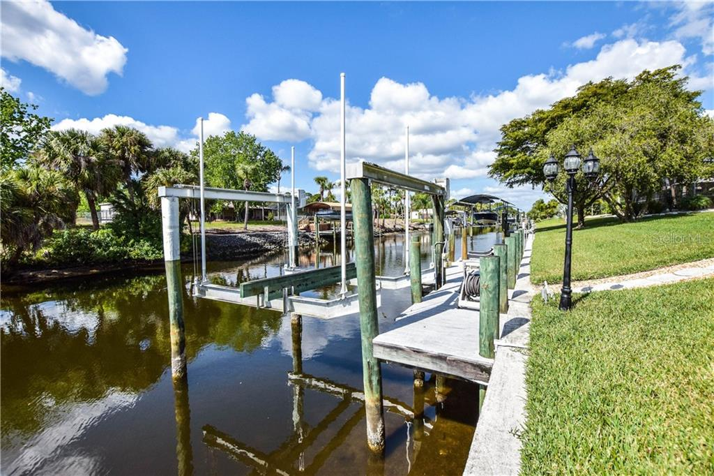 Boat dock and lift. - Single Family Home for sale at 2560 Pebble Creek Pl, Port Charlotte, FL 33948 - MLS Number is N6109100