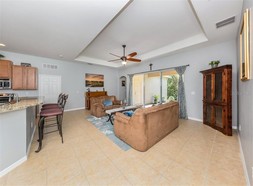 Living Room/Tray Ceiling - Single Family Home for sale at 5417 Layton Dr, Venice, FL 34293 - MLS Number is N6109503