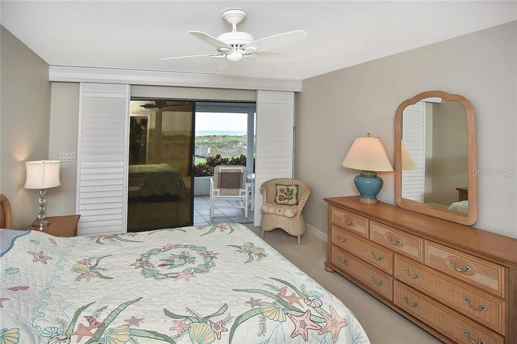 Master bedroom with sliders to lanai - Condo for sale at 862 Golden Beach Blvd #862, Venice, FL 34285 - MLS Number is N6110157