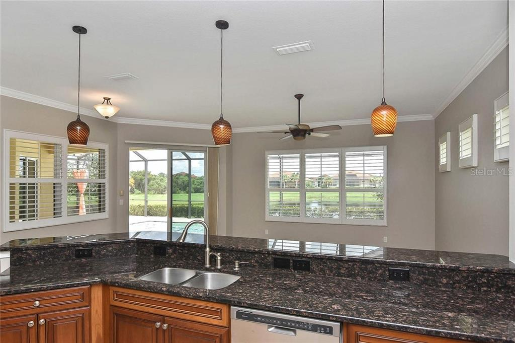 Kitchen to family room - Single Family Home for sale at 193 Medici Ter, North Venice, FL 34275 - MLS Number is N6110365