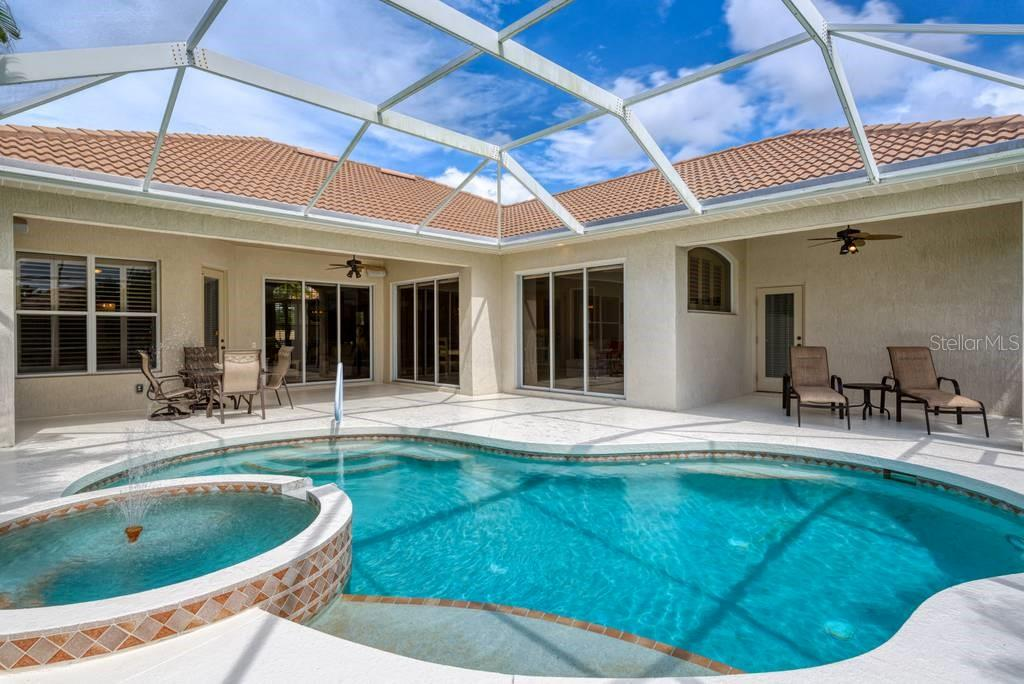 Pool/spa, three sets of sliding glass doors, note - two under roof lounging areas - Single Family Home for sale at 601 Cockatoo Cir, Venice, FL 34285 - MLS Number is N6111658