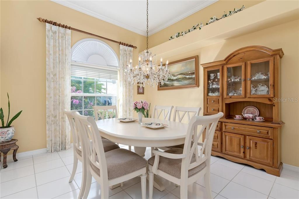 Dining room - Single Family Home for sale at 886 Macaw Cir, Venice, FL 34285 - MLS Number is N6111692