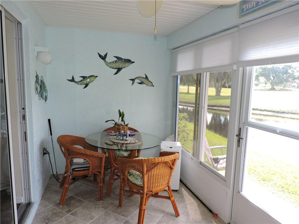 Tiled Lanai area with corner air conditioner - Condo for sale at 1041 Capri Isles Blvd #121, Venice, FL 34292 - MLS Number is N6112042