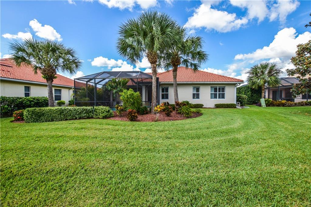 Rear exterior - Single Family Home for sale at 154 Rimini Way, North Venice, FL 34275 - MLS Number is N6112459