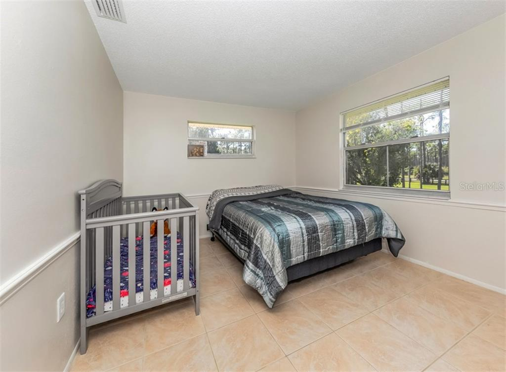 Master bedroom - Single Family Home for sale at 9425 Myakka Dr, Venice, FL 34293 - MLS Number is N6112567