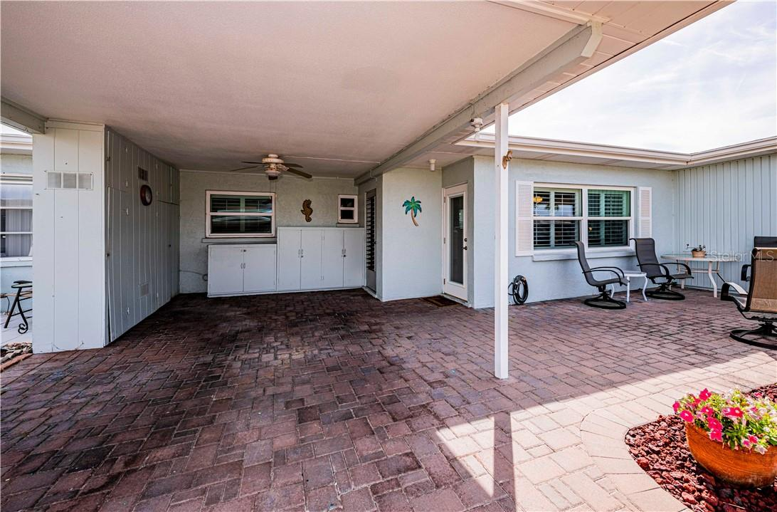 Washer/dryer hook ups in laundry room off carport - Villa for sale at 1019 Beach Manor Ctr #35, Venice, FL 34285 - MLS Number is N6114592
