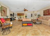 Living room, family room and entry - Single Family Home for sale at 925 Harbor Dr S, Venice, FL 34285 - MLS Number is N5913682