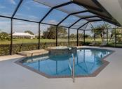Pool with view of golf course - Single Family Home for sale at 431 Tremingham Way, Venice, FL 34293 - MLS Number is N5915386