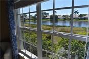 Lake view from master bedroom - Condo for sale at 903 Addington Ct #102, Venice, FL 34293 - MLS Number is N5916962