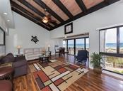 Cathedral and wood beam ceilings make this space feel open and tropical. Custom trim and lighting were added as part of the renovation. - Condo for sale at 500 Park Blvd S #67, Venice, FL 34285 - MLS Number is N6100360