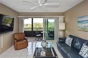Living room to lanai - Condo for sale at 512 W Venice Ave #506, Venice, FL 34285 - MLS Number is N6100462