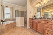 Master bath view 1 - Single Family Home for sale at 20145 Cristoforo Pl, Venice, FL 34293 - MLS Number is N6100537