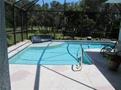 Private pool acre with wooded view - Single Family Home for sale at 2405 Uppakrik Ln, Nokomis, FL 34275 - MLS Number is N6100812