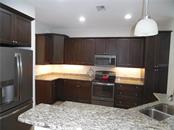 kitchen has granite counter tops and slate appliance package - Single Family Home for sale at 239 Nolen Dr, Venice, FL 34292 - MLS Number is N6101457