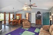 Living room, dining room - Single Family Home for sale at 3572 January Ave, North Port, FL 34288 - MLS Number is N6102434