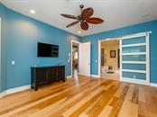 Master bedroom to master bath - Single Family Home for sale at 735 Eagle Point Dr, Venice, FL 34285 - MLS Number is N6103576