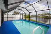 Pool overlooking Lake - Single Family Home for sale at 41 Caroll Cir, Englewood, FL 34223 - MLS Number is N6104860