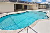 Pool/lanai - Single Family Home for sale at 2232 E Village Cir, Venice, FL 34293 - MLS Number is N6105697