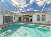 Pool, lanai - Single Family Home for sale at 4956 Stonecastle Dr, Venice, FL 34293 - MLS Number is N6107106