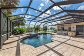 Beautiful pool, spa and outdoor kitchen. - Single Family Home for sale at 262 Pesaro Dr, North Venice, FL 34275 - MLS Number is N6107589