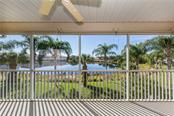 View of lake from lanai - Condo for sale at 891 Norwalk Dr #205, Venice, FL 34292 - MLS Number is N6108169