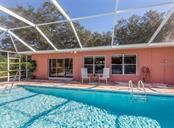 Pool, back of house - Single Family Home for sale at 500 Harbor Dr S, Venice, FL 34285 - MLS Number is N6108518