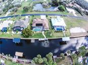 Aerial view. - Single Family Home for sale at 2560 Pebble Creek Pl, Port Charlotte, FL 33948 - MLS Number is N6109100