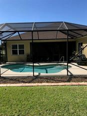 Looking at the pool from the backyard - Single Family Home for sale at 19694 Cobblestone Cir, Venice, FL 34292 - MLS Number is N6109367