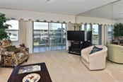 Living room - Condo for sale at 1150 Tarpon Center Dr #303, Venice, FL 34285 - MLS Number is N6110126