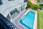 Pool View from upper Master Suite - Single Family Home for sale at 510 Bowsprit Ln, Longboat Key, FL 34228 - MLS Number is N6110334